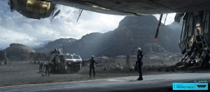 Film still of Prometheus crew landing in front of the 'pyramid'