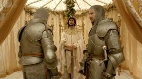 Richard in his fluffy robe banishes Mowbray and Bolingbroke